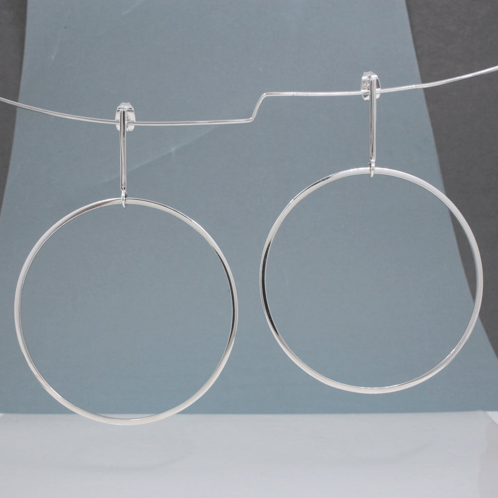 "These RADA G Sterling Silver Hoop Post Earrings Measure 50 Millimeters In Diameter By 1.5 Millimeters Thick, and 69 Millimeters Long From Top Of Ear Wire. (2"" Diameter By 1/16"" Thick, and 2 11/16"" Long From Top Of Ear Wire)