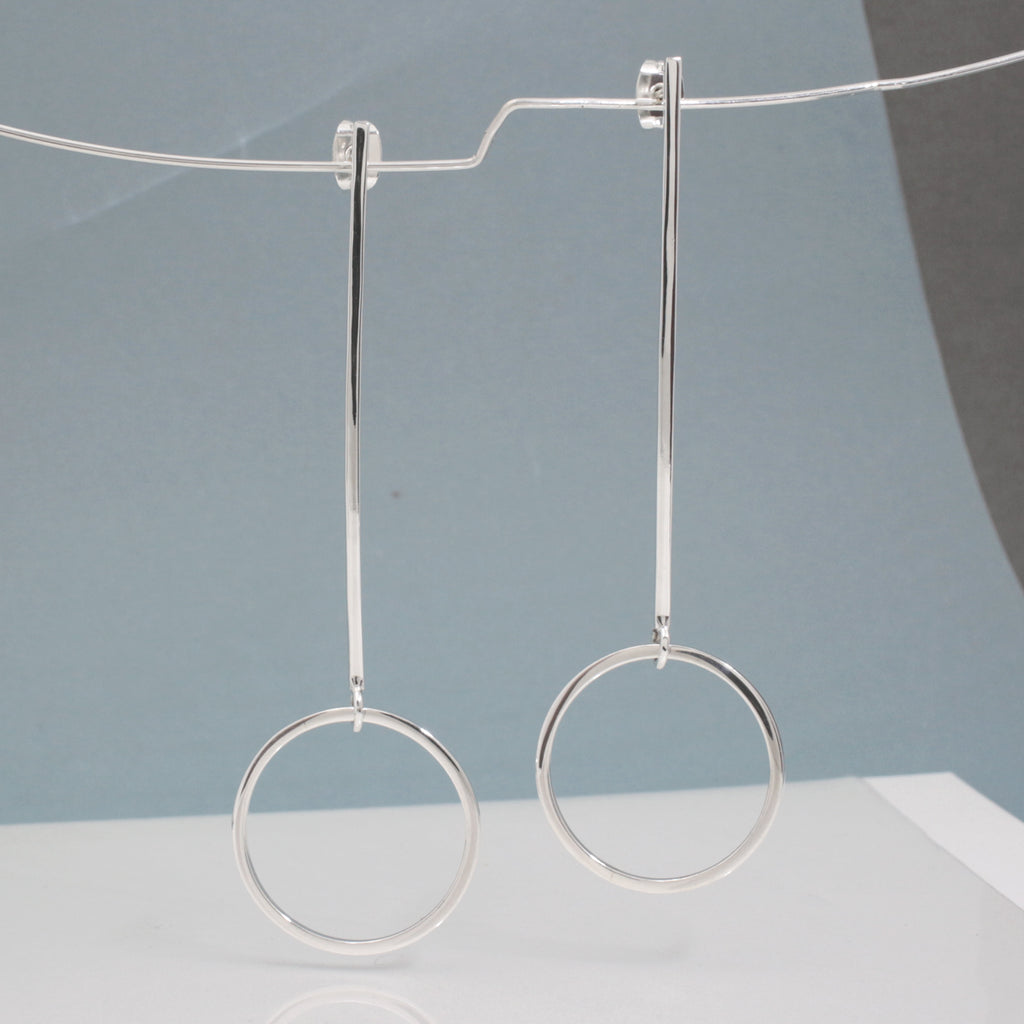 "These RADA G Long Sterling Silver Hoop Post Earrings Measure 24 Millimeters In Diameter By 1.5 Millimeters Thick, and 75 Millimeters Long From Top Of Ear Wire. (7/8"" Diameter By 1/16"" Thick, and 2 7/8"" Long From Top Of Ear Wire) Sterling Silver Friction Post . Made Using .925 Sterling Silver With High Polished Sterling Silver Finish."