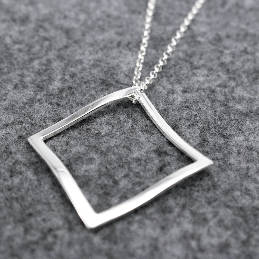 "This AYA Outer Square Sterling Silver Pendant Features A High Polished Sterling Silver Finish. 2.5 Millimeters Sterling Silver Rolo Chain Is Included. Pendant Measures 35 Millimeters By 35 Millimeters (1.3/8"" By 1.3/8""). Outline Thickness Is 3 Millimeters.  2.5 Millimeters Sterling Silver Rolo Chain With A Lobster Claw Clasp Loop Thru Pendant. The Necklace Can Be Worn At 24"" Or At 26"" In Length. This Pendant Is Made Using .950 Sterling Silver With High Polished Sterling Silver Finish."