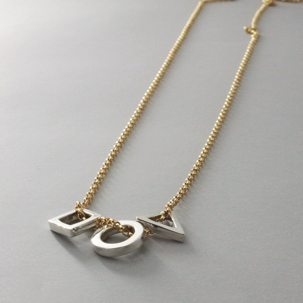 This GeomeThree Charms Necklace Features A High Polished Sterling Silver Finish.  Measures:  Square Charm ~9 Millimeters Long X 9 Millimeters Wide Circle Charm ~ 10 Millimeters In Diameter Triangle Charm ~ 10 Millimeters Long X 10 Millimeters Wide All Of Them Are 2 Millimeters Deep