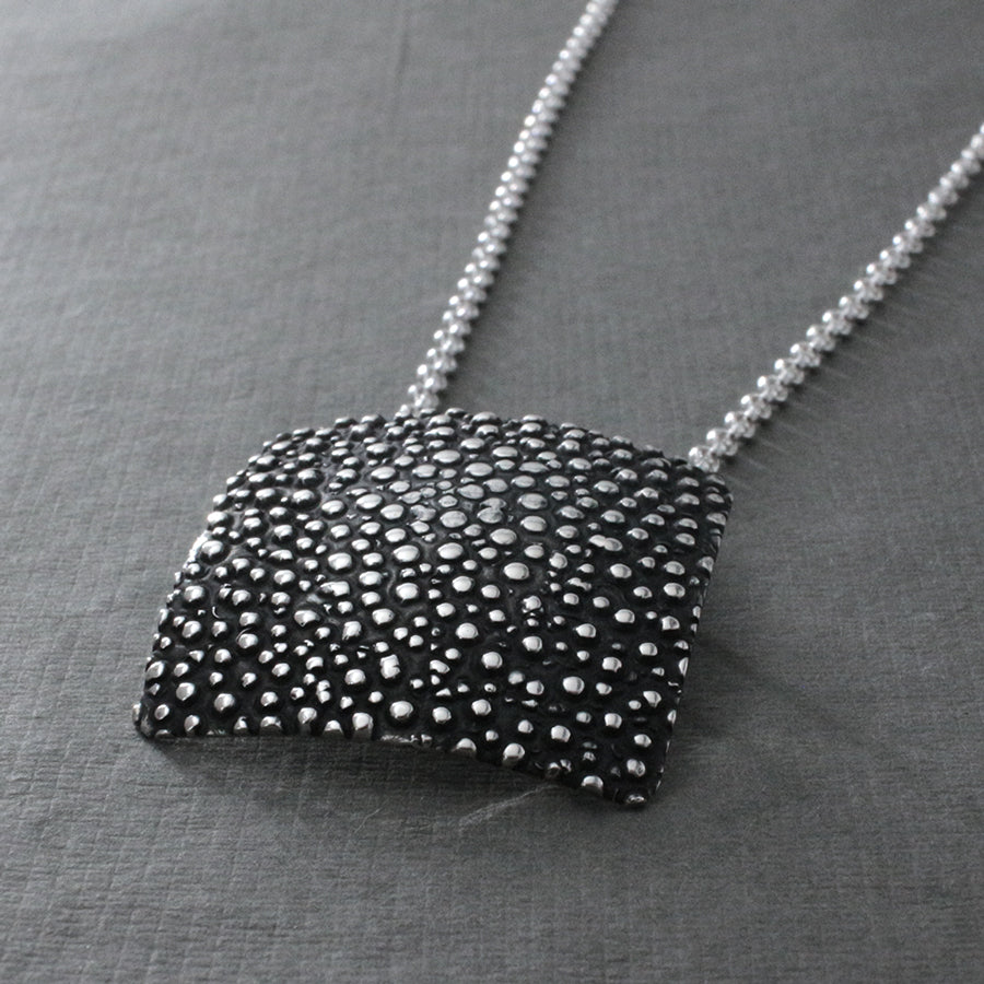 "This Square Dotted Sterling Silver Pendant Features A Oxidized Sterling Silver Finish. Measures 31 Millimeters Long By 31 Millimeters Wide (1.3/16"" Long By 1.3/16"" Wide). The Price Includes A 2.5 Millimeters Sterling Silver Rolo Chain With A Lobster Claw Clasp. The Chain Is Adjustable And Can Be Worn At 16"" Or 18"" In Length. Bail Fits Up To 5 Millimeters Chain. This Pendant Is Made Using .950 Sterling Silver With Oxidized Sterling Silver Finish."