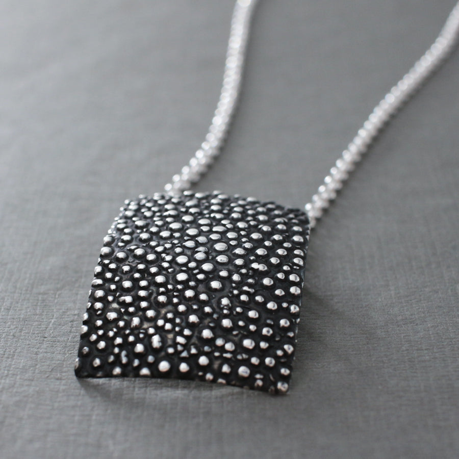 "This Rectangle Sterling Silver Pendant Features A Oxidized Sterling Silver Finish. Measures 34 Millimeters Long By 25 Millimeters Wide (1.5/16"" Long By 1"" Wide). The Price Includes A 2.5 Millimeters Sterling Silver Rolo Chain With A Lobster Claw Clasp. The Chain Is Adjustable And Can Be Worn At 16"" Or 18"" In Length. Bail Fits Up To 5 Millimeters Chain. This Pendant Is Made Using .950 Sterling Silver With Oxidized Sterling Silver Finish."