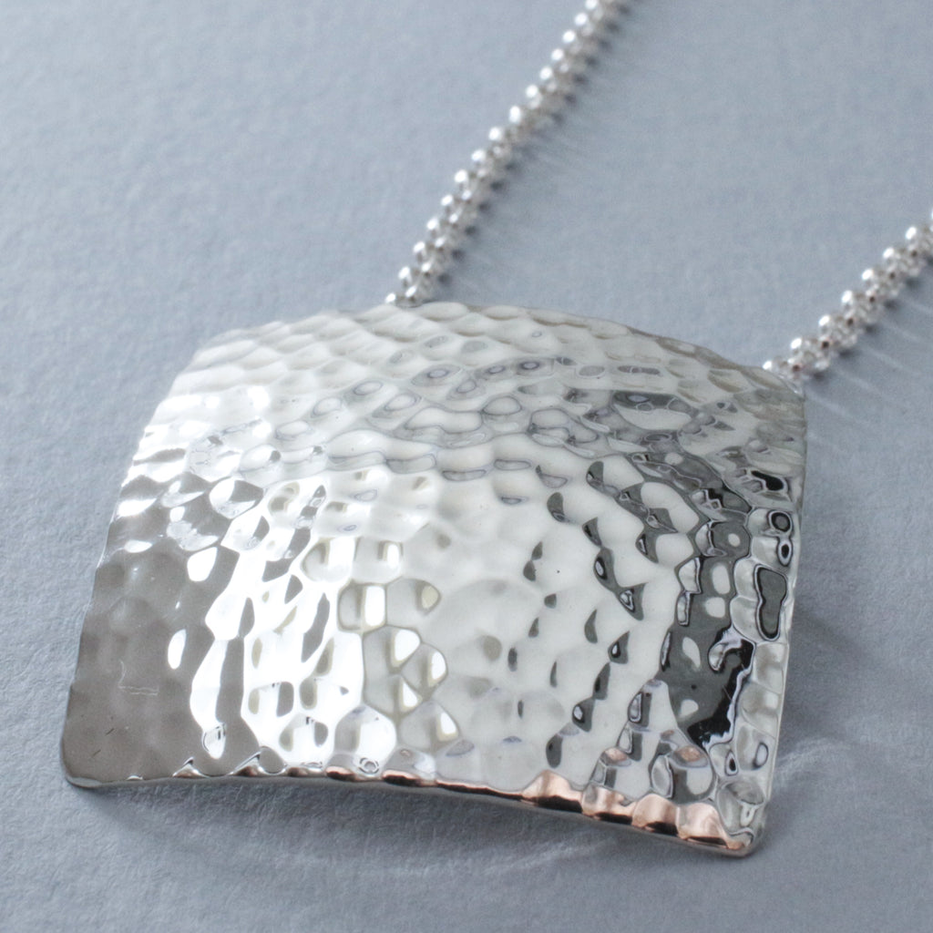 "This Artemis Square Sterling Silver Pendant Features A Hammered Sterling Silver Finish. Measures 31 Millimeters Long By 31 Millimeters Wide (1.3/16"" Long By 1.3/16"" Wide). The Price Includes A 2.5 Millimeters Sterling Silver Rolo Chain With A Lobster Claw Clasp. The Chain Is Adjustable And Can Be Worn At 16"" Or 18"" In Length. Bail Fits Up To 5 Millimeters Chain. This Pendant Is Made Using .950 Sterling Silver With Hammered Sterling Silver Finish."