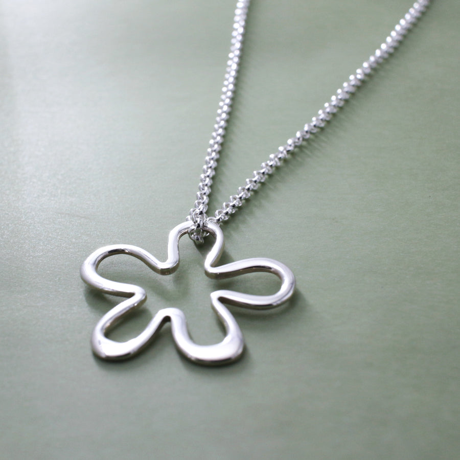 "This Daisy Silhouette Flower Sterling Silver Pendant Features A High Polished Sterling Silver Finish. 2.5 Millimeters Sterling Silver Rolo Chain Is Included. Pendant Measures 33 Millimeters Long By 31 Millimeters Wide (1.5/16"" Long By 1.1/4"" Wide). Outline Thickness Is 2.5 Millimeters."