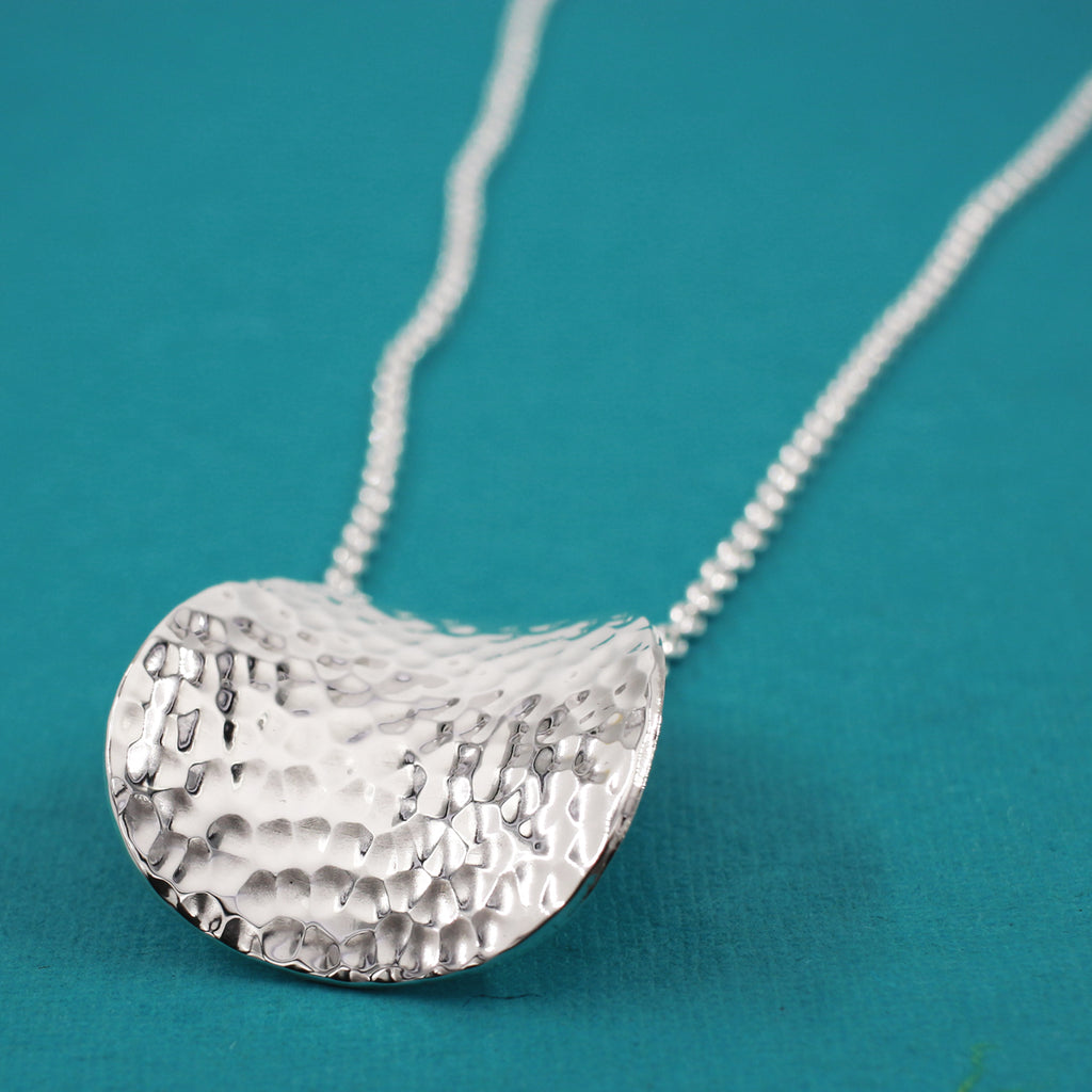 "This Daisy Petal Sterling Silver Pendant Features A Hammered Sterling Silver Finish. Measures 33 Millimeters Long By 29 Millimeters Wide (1.1/4"" Long By 1.1/8"" Wide). The Price Includes A 2.5 Millimeters Sterling Silver Rolo Chain With A Lobster Claw Clasp. The Chain Is Adjustable And Can Be Worn At 16"" Or 18"" In Length. Bail Fits Up To 6 Millimeters Chain. This Pendant Is Made Using .950 Sterling Silver With Hammered Sterling Silver Finish."