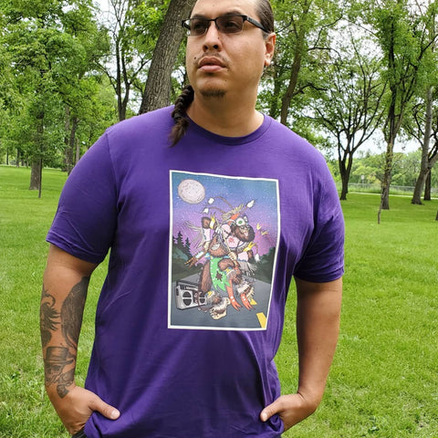 Sean Rayland from Red Rebel Armour posing in the park wearing the Pow Wow Sabe Purple Tee.