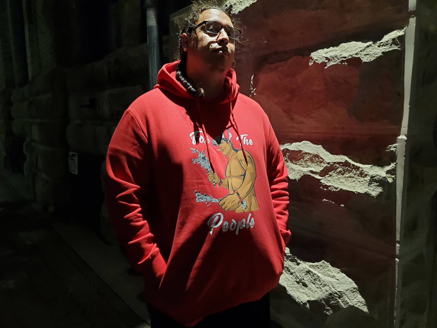 Sean Rayland wearing the For The People Red Hoodie