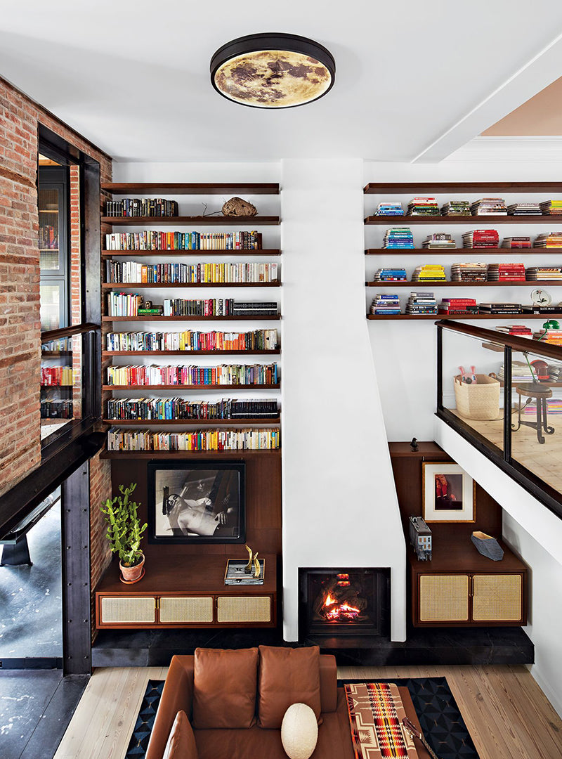 This Cobble Hill <br> Townhouse Has  A <br> Two Story Bookshelf Moon Light and Climbing Wall