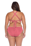 Model posing in the BECCA ETC Color Code Women's Plus Size Pink Bralette Bikini Top