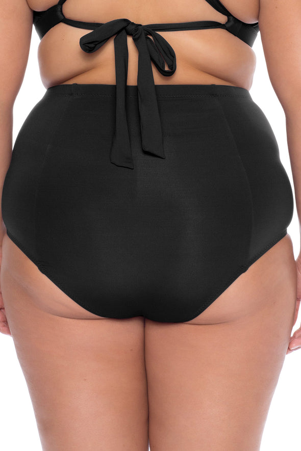 Model's back posing in the BECCA ETC Color Code women's black plus size vintage hi waist bikini bottom pant