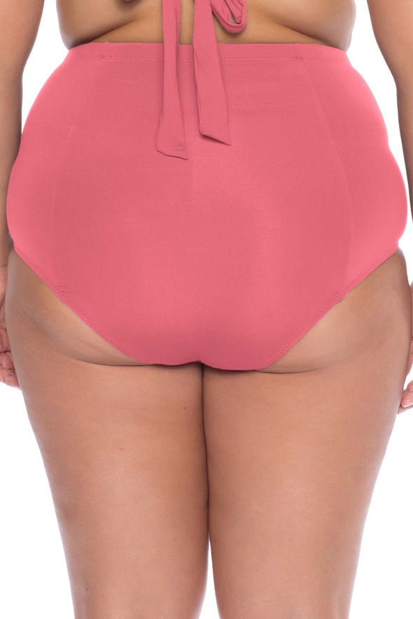 Model posing in the BECCA ETC Color Code Women's pink plus size vintage bikini bottom swimsuit
