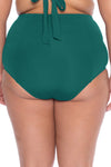 Model posing in the BECCA ETC Color Code Women's green fern colored plus-sized vintage bikini bottom swimsuit