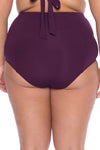 Model posing in the BECCA ETC Color Code Women's red merlot colored plus-sized vintage bikini bottom swimsuit