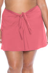 Model posing in the BECCA ETC Color Code Women's pink plus size sarong skirt