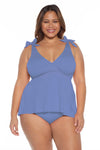 Model posing in the BECCA ETC Color Code Women's blue plus size bikini bottom
