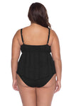 Model posing in the BECCA ETC Color Play Women's black plus size crochet tankini swimsuit top