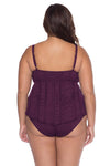 Model posing in the BECCA ETC Color Play Women's purple plus size crochet tankini swimsuit top
