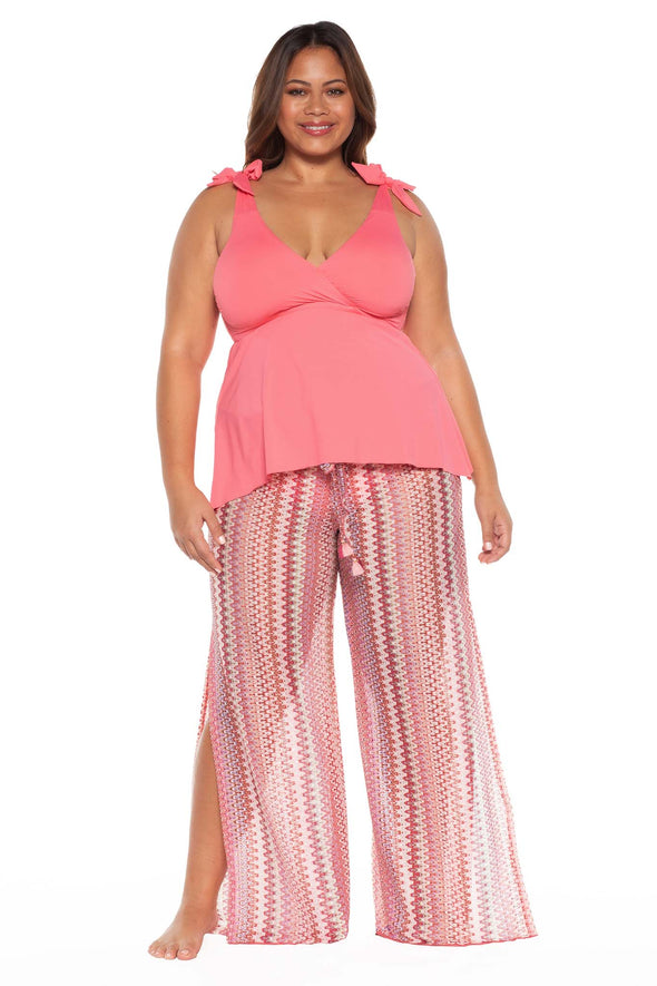 Model posing in the BECCA ETC Pierside Women's pink plus size pant