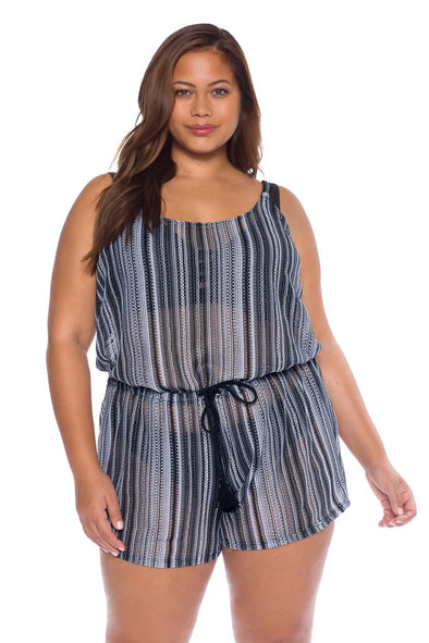 Model posing in the BECCA ETC Pierside Women's Black colored plus-sized romper