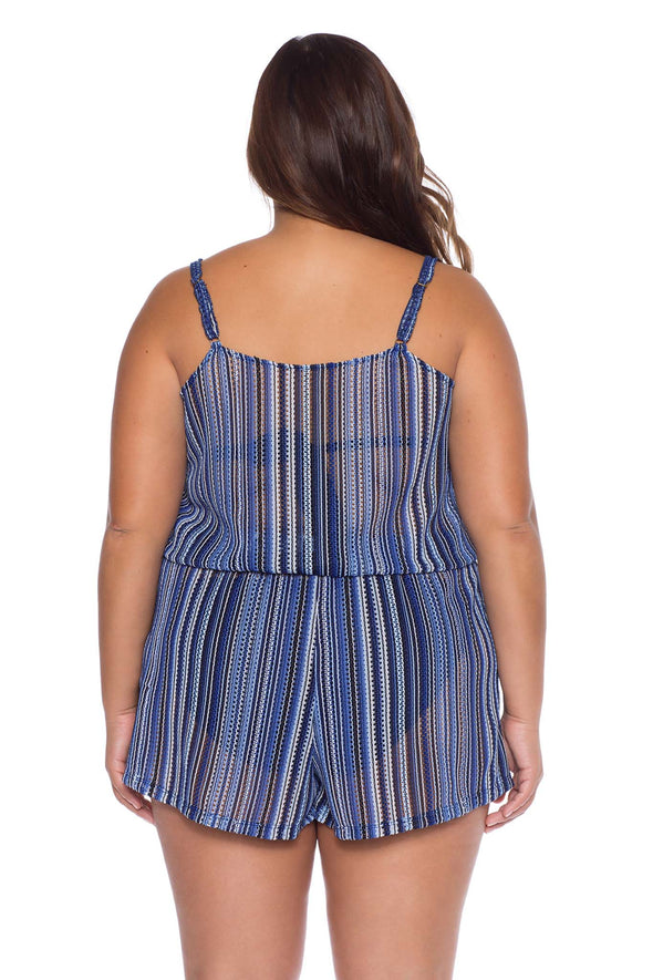 Model posing in the BECCA ETC Pierside Women's indigo colored plus-sized romper