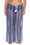 Model posing in the BECCA ETC Pierside Women's indigo colored plus-sized pant