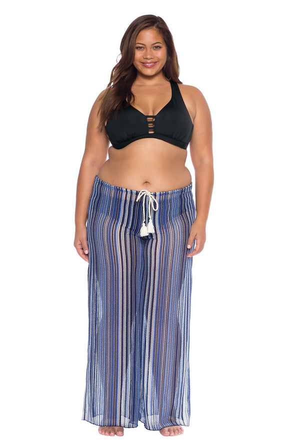Model posing in the BECCA ETC Pierside Women's purple plus size pant