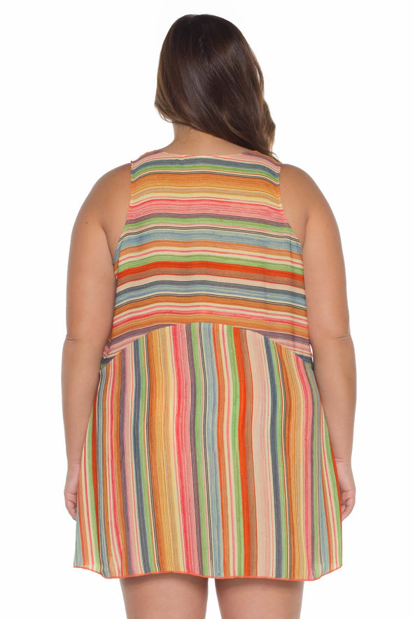 Model posing in the BECCA ETC West Village Women's multi-colored plus-sized dress