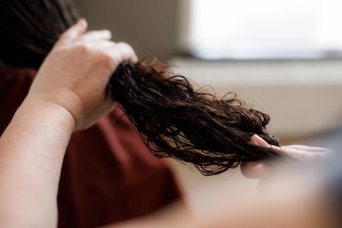 Woman Girl with curly hair shampooing rinse shampoo