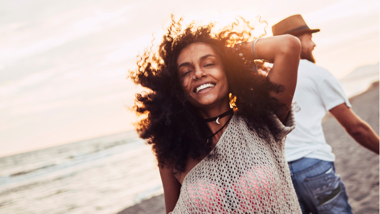 Woman with curly hair enjoying the summer and sun