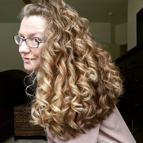 Woman with big, curly blond hair