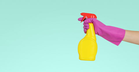 Colorful disinfectant bottle by MopTop Junk Free Office
