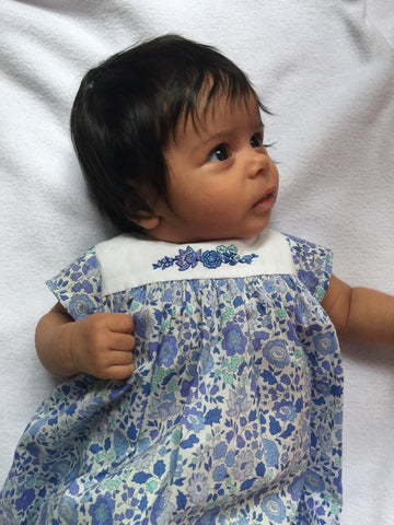 Nina's very first Liberty dress with handmade embroideries