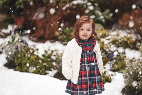 Amelie playing in the snow in her Ninon smocked dress! What a beauty!!