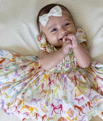 Arden in her Liberty Netti smocked dress