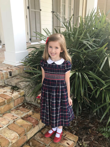 Frazier in her Tartan smocked Cerise dress looking ever so sweet!