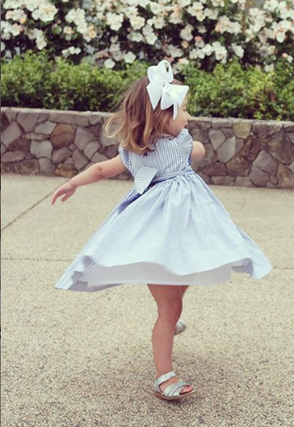 handmade smocked dress twirling happy client charlotte sy dimby