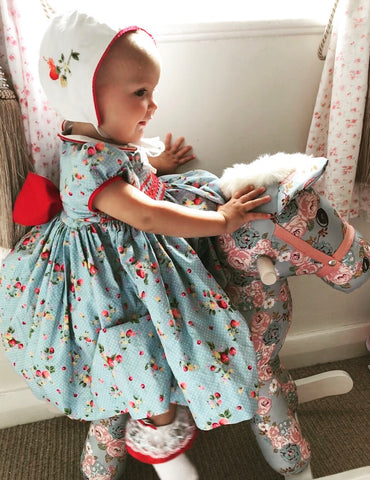 Thank you to Hâf for looking so sweet and princess like in her handmade Strawberry print Cerise Fabrice smocked dress.