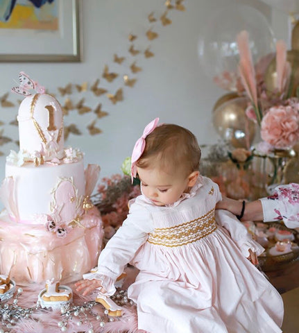 Pink velvet handmade smocked dress with golden details