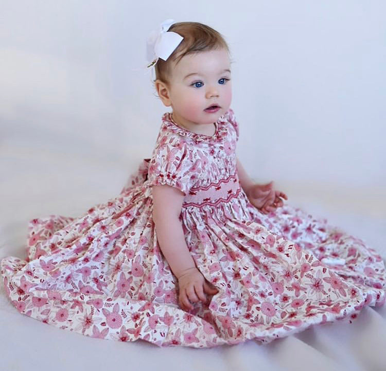 Elle in our handmade Amandine smocked dress