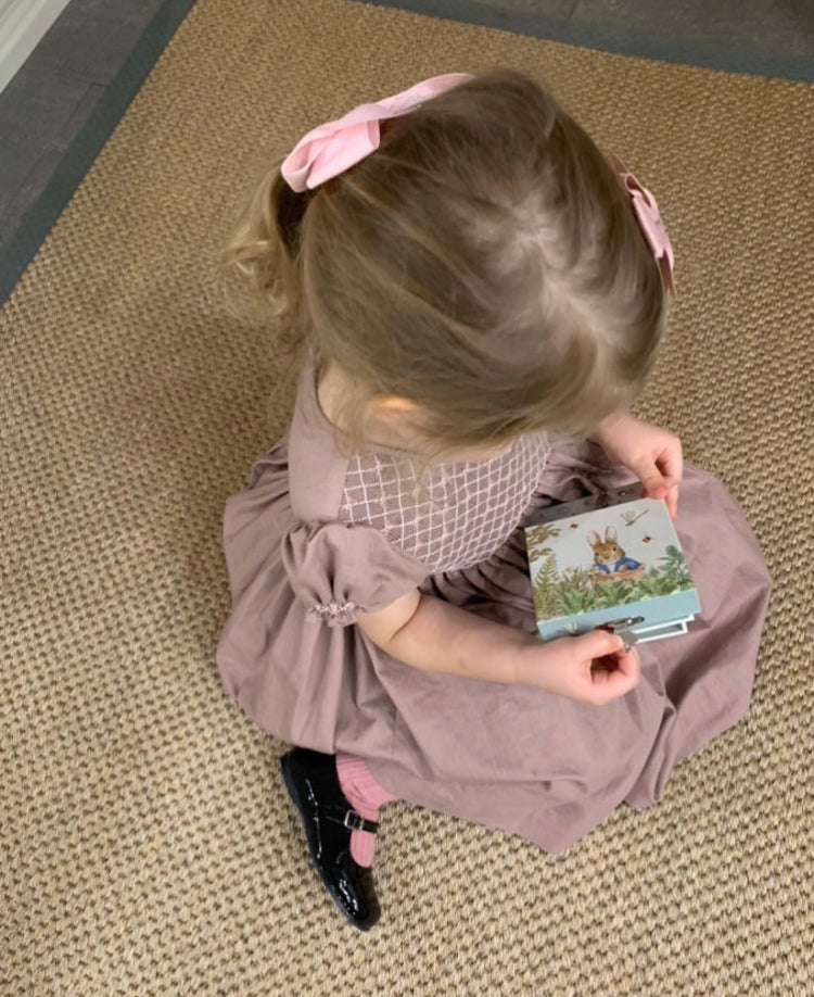 Aurora in our Preppy smocked dress