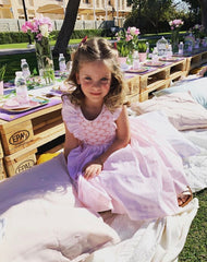 Lola in her summer handmade pink Netti smocked dress