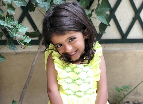Beautiful little princess in her handmade yellow Netti dress.  Looking like a blooming flower, this darling is adorable! What a pleasure to see our dresses worn with such a big smile!