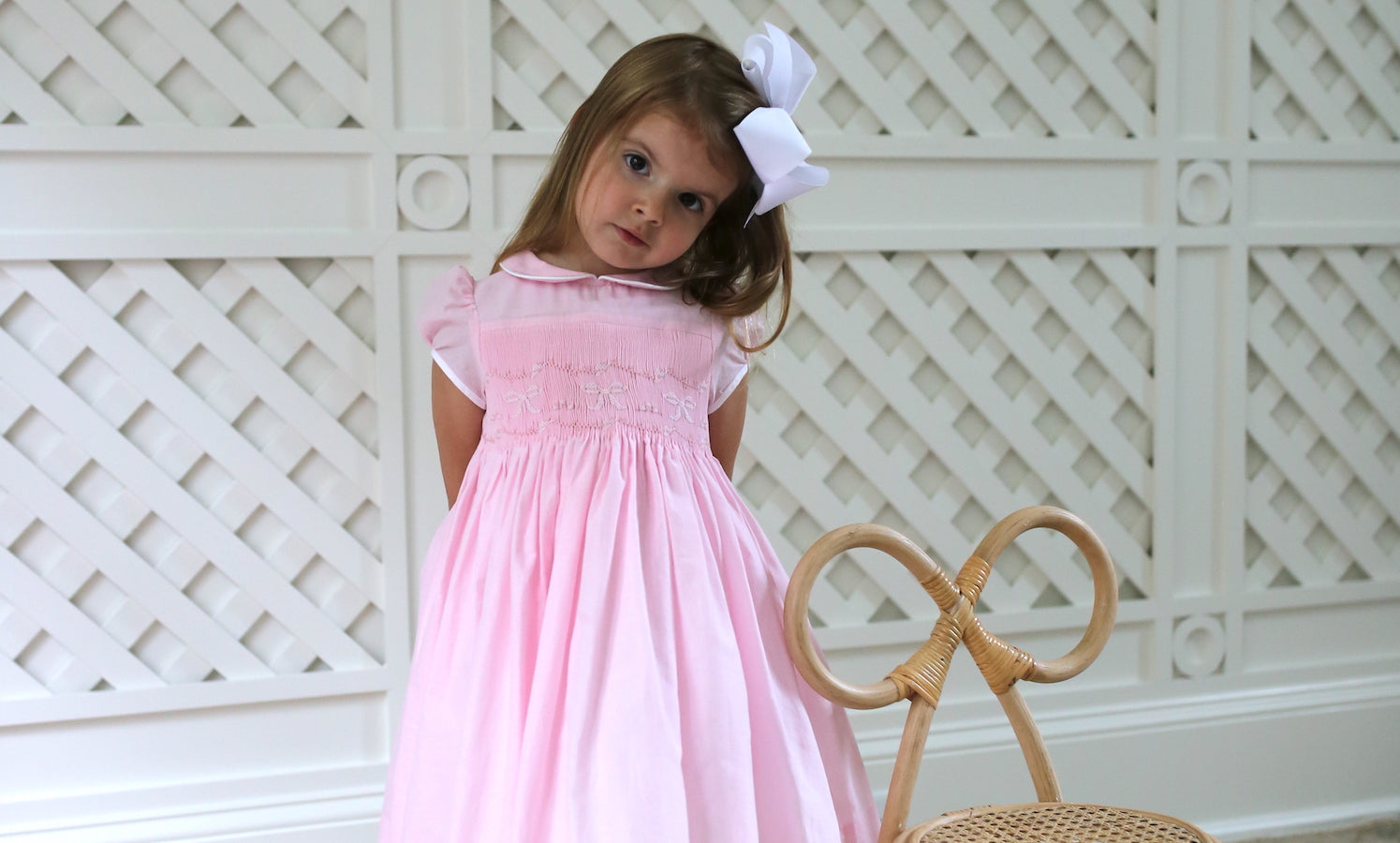 Timeless classic bows and blue pink dress Emily Hertz