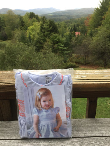 """My niece just had her first baby. The new mom received many nice presents but insists that this dress is her favorite!"" - Bill - Moretown, Vermont, USA Thank you so much for this beautiful picture. Our dresses travel the world to fufill the dreams of little girls all around the planet. We could not have dreamed of a more poetic, soothing and peaceful landscape."