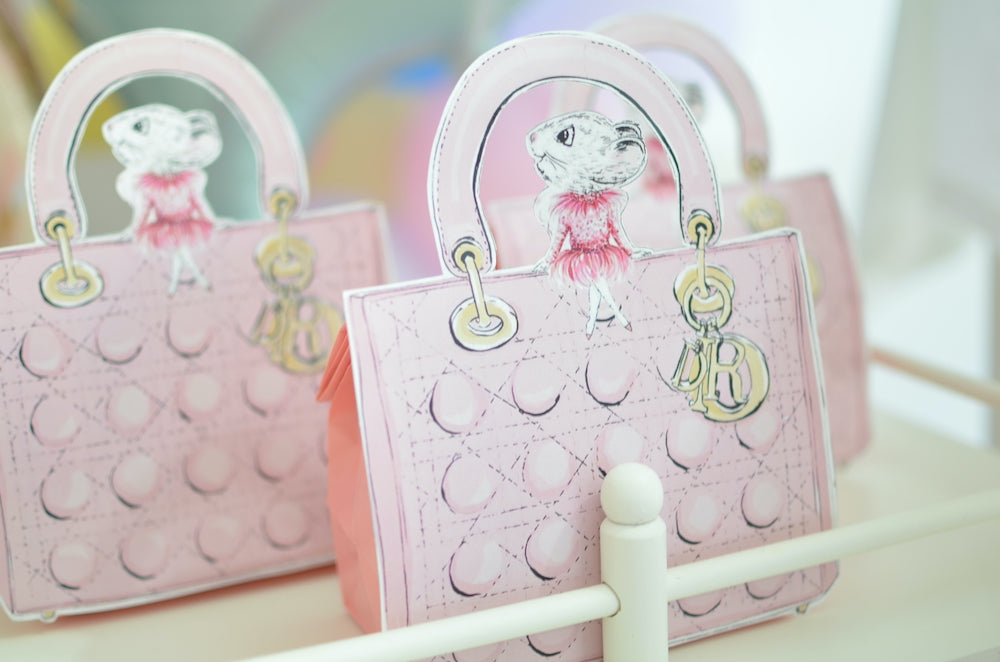 Charlotte sy Dimby and Claris the mouse in Paris party inspiration for children pink dior handbags party favors