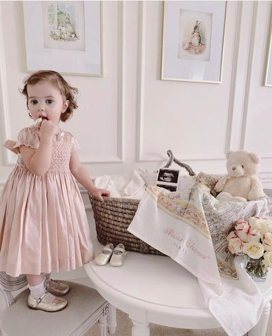 happy client charlotte sy dimby preppy raw silk smocked dress pink