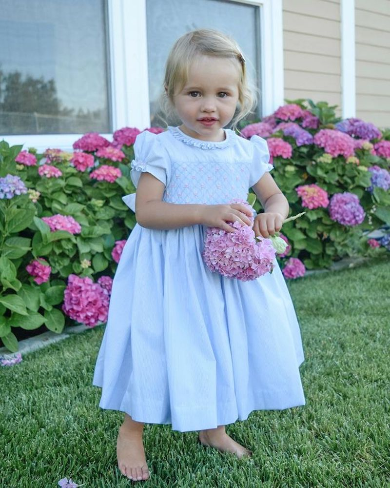 Charlotte sy Dimby and Shari traditional child portrait in smocked dress