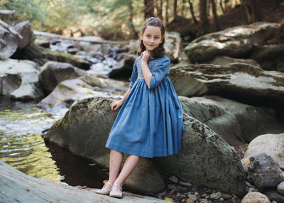 Japanese blue Douce smocked dress with golden smocks. A precious chic timeless look for girls