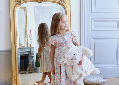 Beautiful handmade floral print smocked dress for babies and girls. A chic and joyful French style for children.