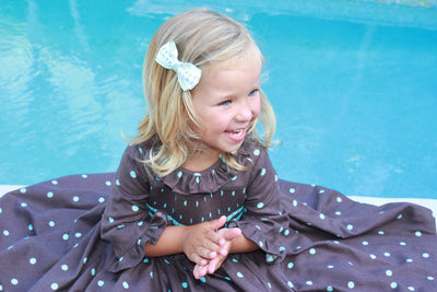 handmade smocked dress charlotte sy dimby  timeless style portrait girl brown ruffle paris